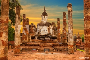 Picture of Huge Buddha statue at sunset. Wat Mahathat (temple). Sukhothai Historical Park, Thailand. Unesco World Heritage Site.