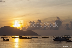 Picture of Beautiful sunrise seascape view with boat in phuket island.