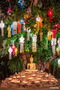Picture of Buddha statue surounded by candles during Loy Kratong Festival,