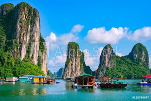 Picture of Floating fishing village and rock island in Halong Bay, Vietnam, Southeast Asia. UNESCO World Heritage Site. Junk boat cruise to Ha Long Bay. Landscape. Popular landmark, famous destination of Vietnam