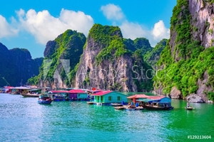 Picture of Floating fishing village rock island in Halong Bay Vietnam, Southeast Asia. UNESCO World Heritage Site. Junk boat cruise to Ha Long Bay. Landscape. Popular asian landmark famous destination of Vietnam