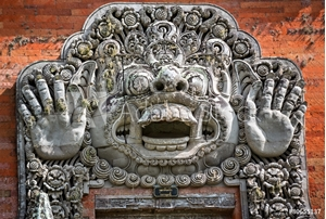 Picture of carvings depicting demons or gods above the entrance to the temp