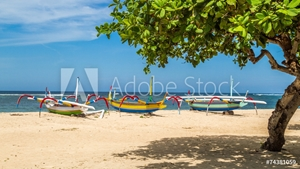 Picture of beach in bali, three boats ready to sail
