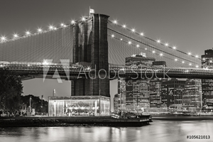 Picture of Black and White of  Brooklyn Bridge Tower at twilight with carousel and skyscrapers of Lower Manhattan. Financial District. New York City