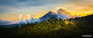 Picture of Arenal Volcano at Sunrise...A rare sight at the perfect 15 second window to capture sunrise in all of it's glory.  Light glistens off the clouds and the mountain and the jungle.